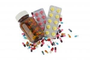 Canister full of capsule medicine and capsule around it